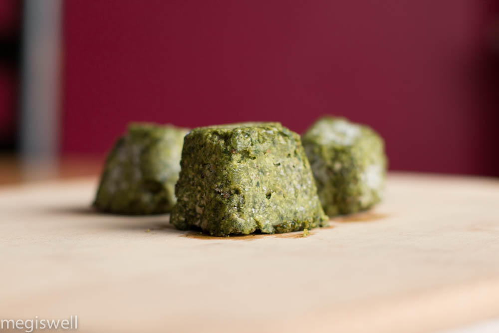 Homemade pesto frozen in ice cube trays