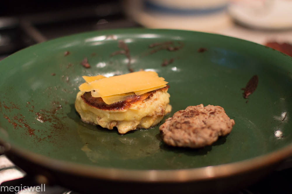 melt cheese on top of cooked egg mcmuffin