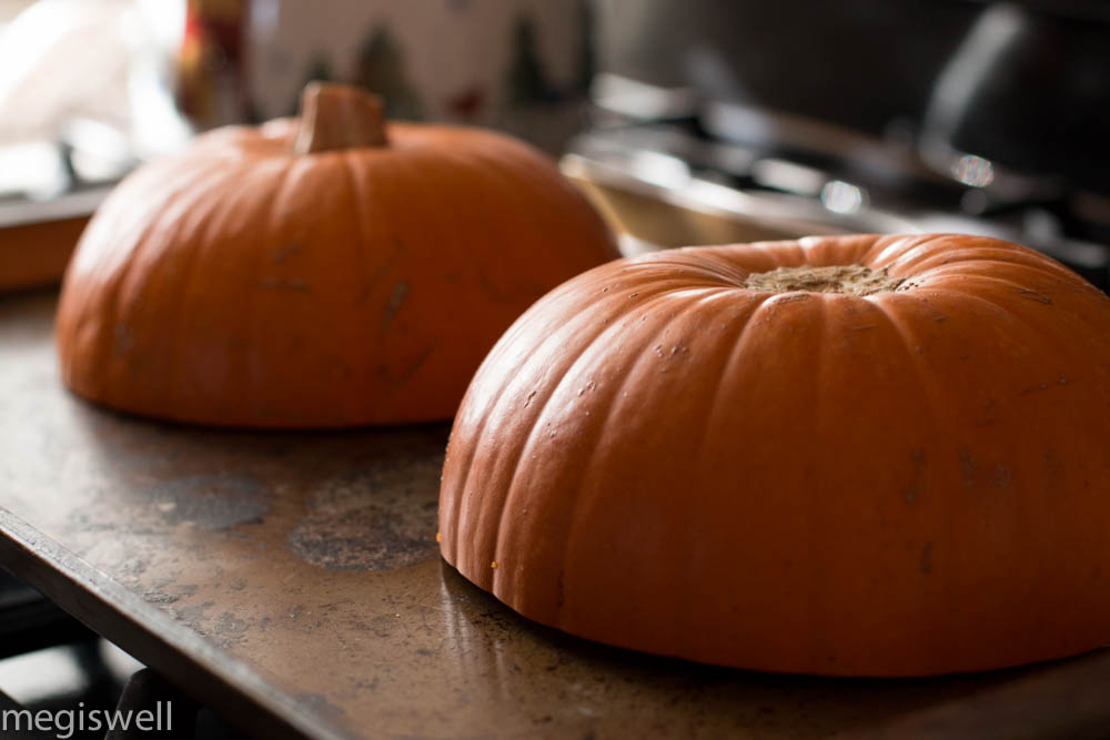 Place the halved pumpkins on a baking sheet, cut side down