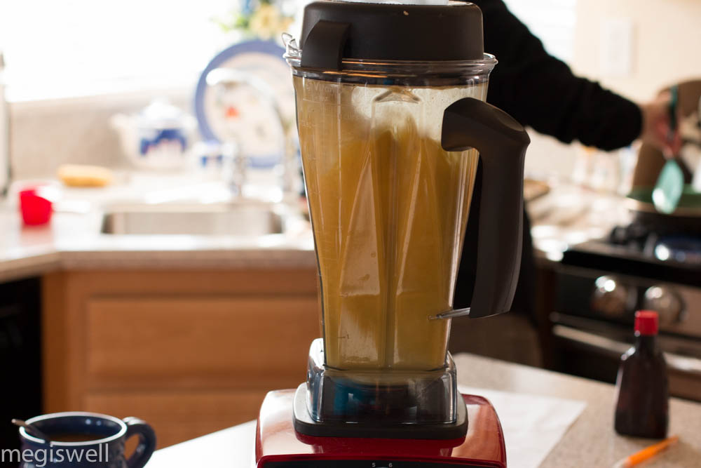 Blending all the ingredients on high in the blender to create a hot and frothy Pumpkin Chai Tea Latte