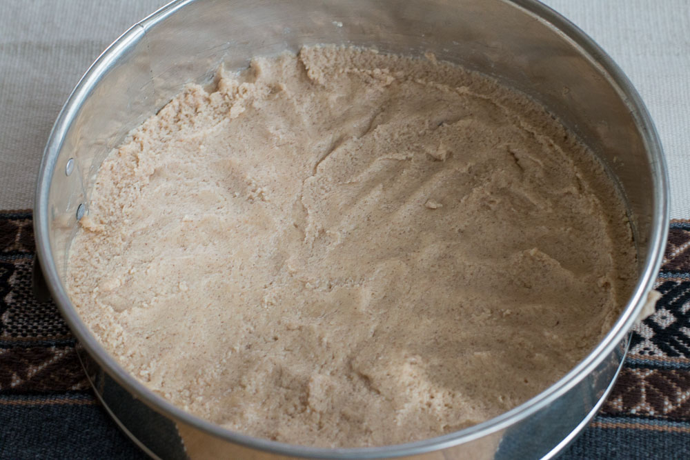 Pat and spread the crust batter onto the bottom of the spring form pan