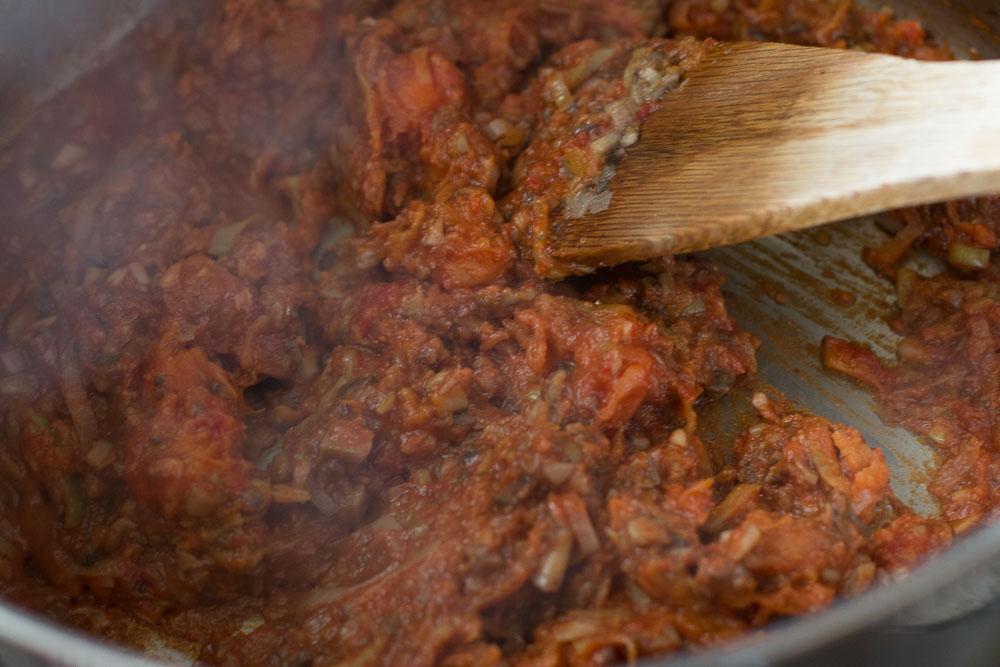 Stirring in the tomato paste and almond flour
