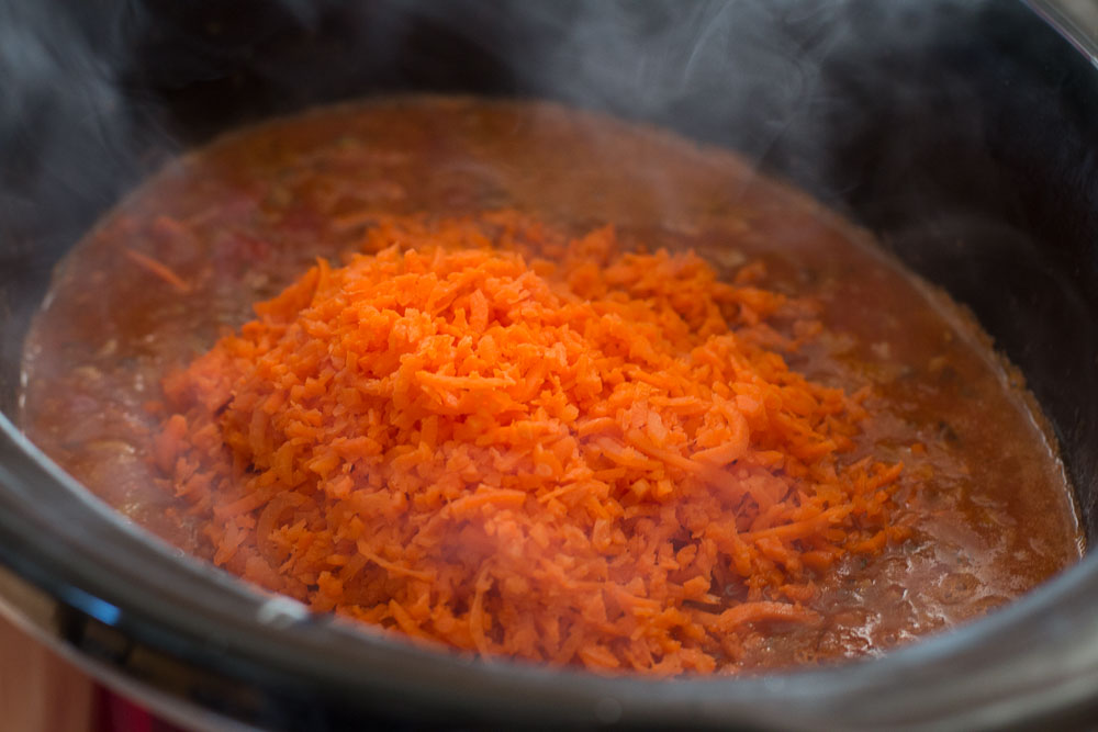 Pour into a slow cooker and add the carrot rice