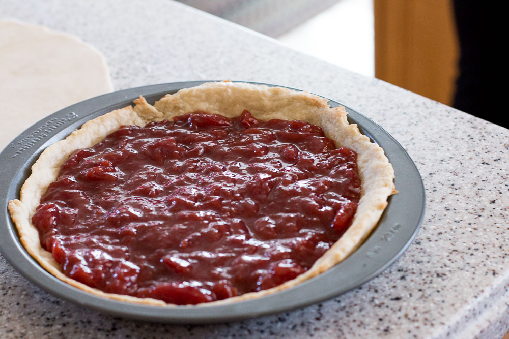 Place the cherry pie filling on top of the cooled pie crust.