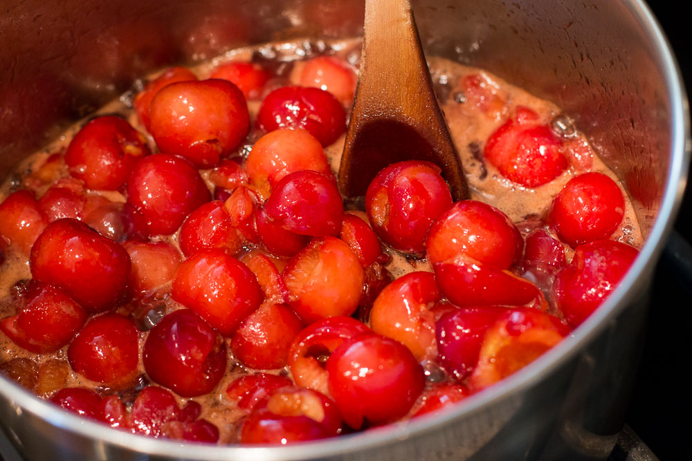 Bring the mixture to a boil and then reduce the heat to low-medium and let it simmer until it is thick.
