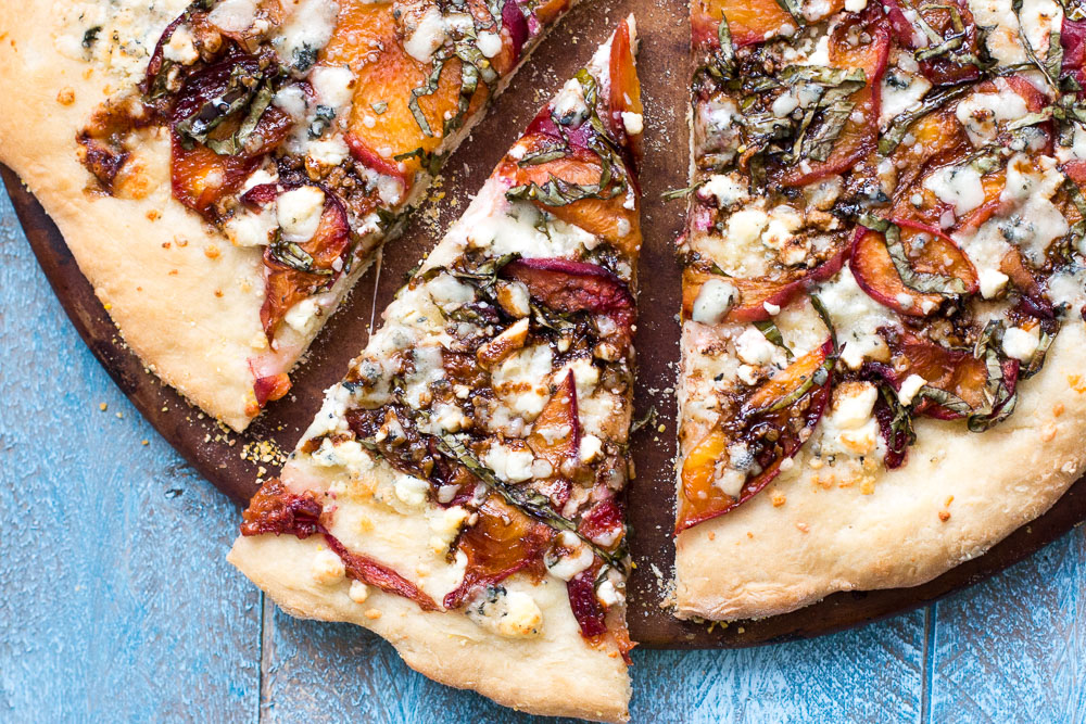 This Just Peachy Pizza uses summer peaches to the best advantage with goat cheese, basil, gorgonzola, and a balsamic drizzle that ties everything together. | www.megiswell.com