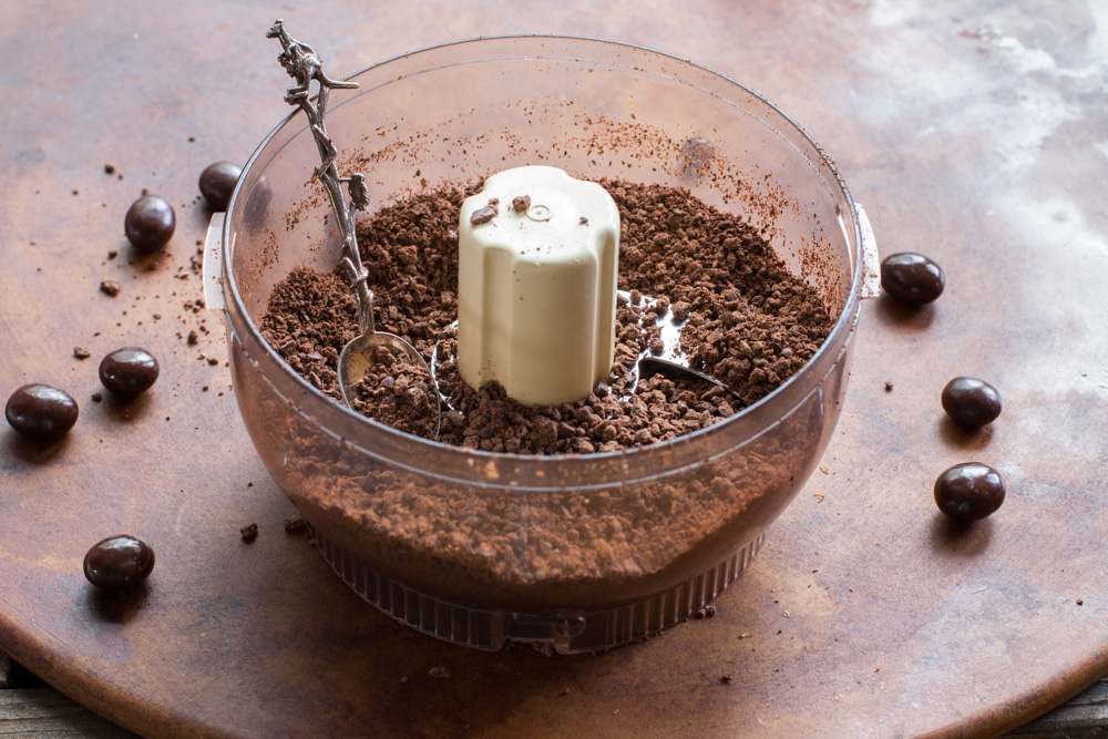 Chocolate covered expresso beans ground in a food processor.