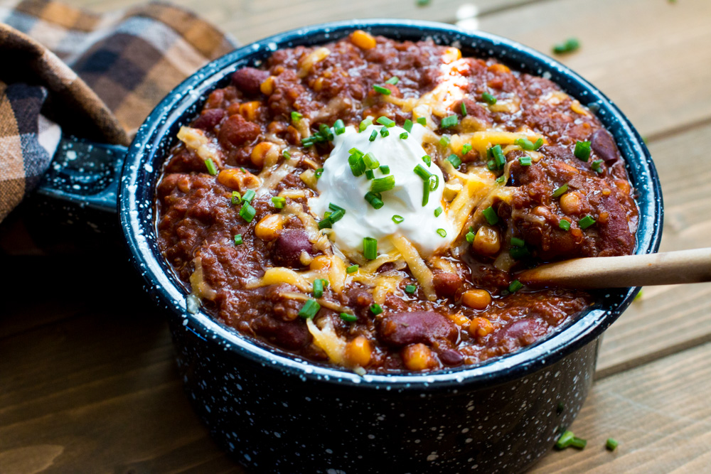 Dried chilies, adobo sauce, and vegetable stock provide rich flavor while beans and quinoa soak it all up in this 3 Bean and Quinoa Vegetarian Chili. | www.megiswell.com