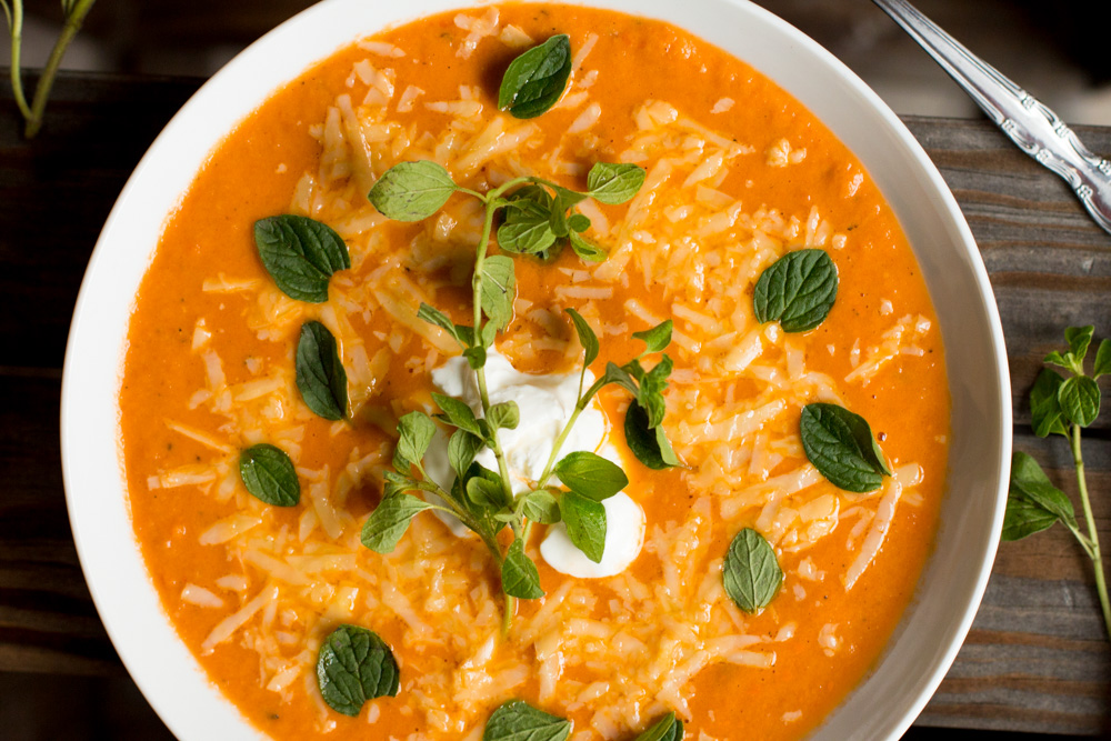 Sprinkle more cheese and add a dollop of sour cream on top of the Fire Roasted Tomato Soup