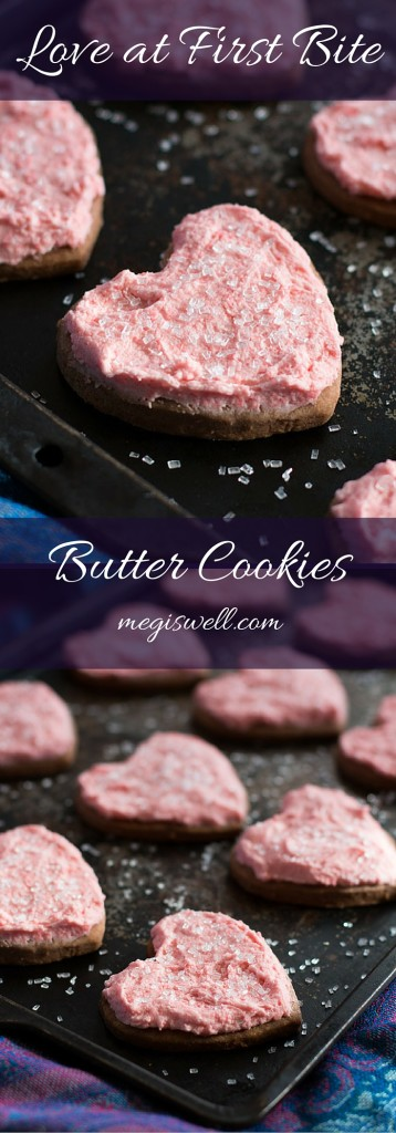 Simple butter cookies are made more delicious by adding finely ground chocolate wafer cookies to the dough. Strawberry wafer cookies also provide a slight pink plush to a creamed butter and powder sugar frosting. | Valentine's Day | Cut Out Frosted Cookies | Heart Shaped Cookies | www.megiswell.com