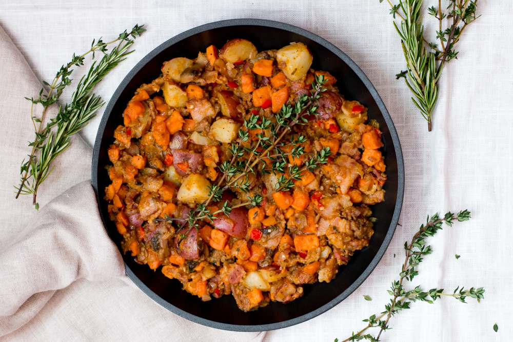 Savory Sweet Potato Hash. Bacon, sausage, onions, bell peppers, mushrooms, herbs, and ancho chili powder pack this breakfast or brunch option with warm and filling flavors. No mid-morning hunger pangs with this meal.