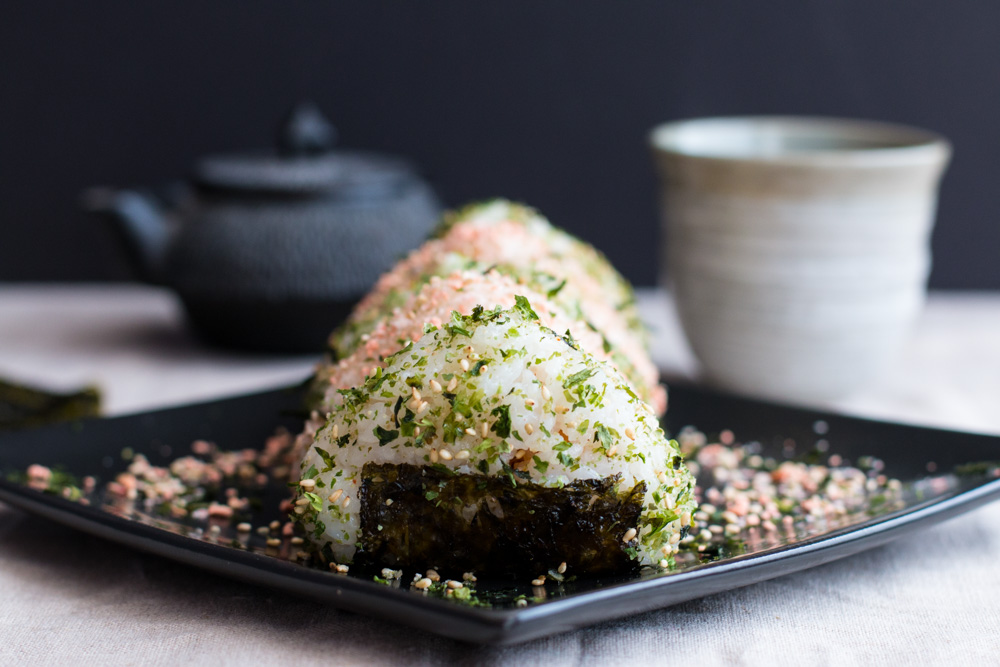 Onigiri Japanese Rice Balls. Lightly seasoned rice containing Spicy Kimchi Tuna or Salmon Furikake and topped with furikake seasoning make great lunches or snacks. Or you can fill them with whatever you want, getting creative with what you have.