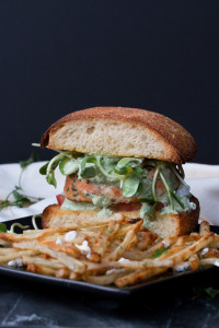 Salmon Burgers with Garlic Dill Fries. Mint, basil, and dill tie juicy Salmon Burgers and crisp Garlic Dill Fries together with their fresh bright flavors. Served with a Mixed Herb Greek Yogurt Dip and crumbled feta, you have a complete meal full of awesome flavor.