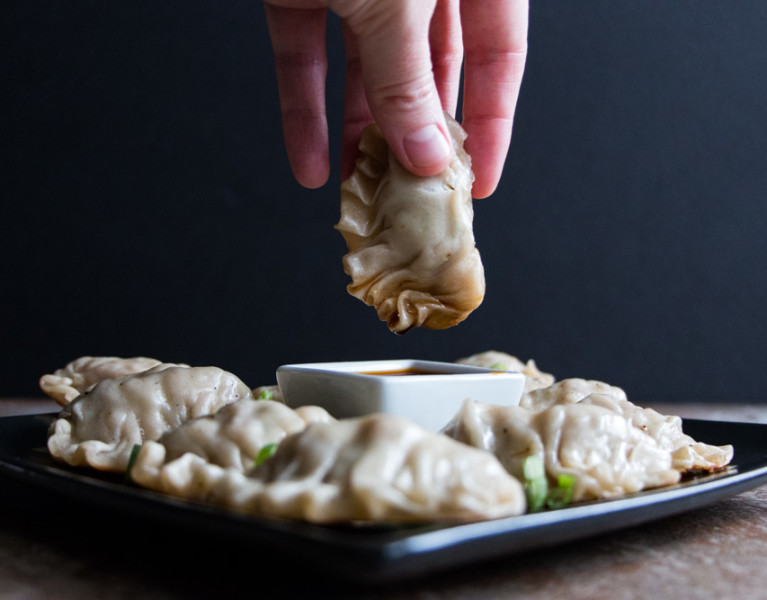 Homemade gyoza make a perfect savory side dish, stuffed with pork, cabbage, mushrooms, and aromatics. While they may seem intimidating to make from scratch, learn how to break them down into easy steps.