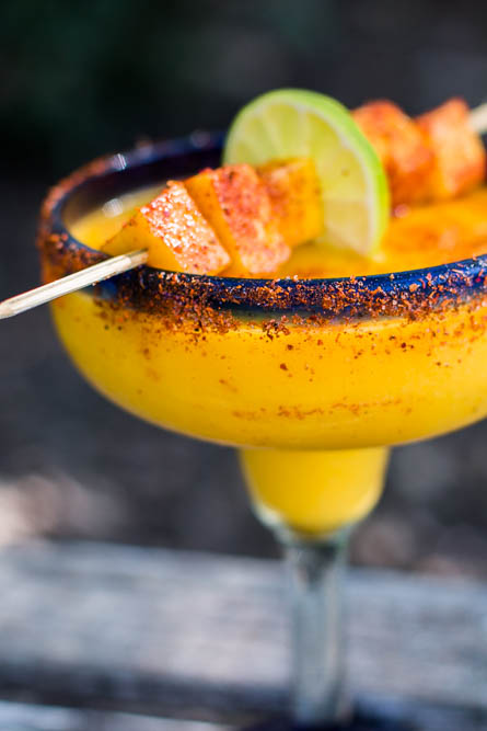 These Mango Margaritas spice things up a bit with a delicious turmeric simple syrup and a sprinkling of Tajin chili seasoning. They can also be frozen and taken to-go on picnics.