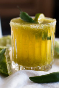 Turn your leftover tomatillo salsa into a tasty Tomatillo Margarita, giving the classic margarita a spicy twist.