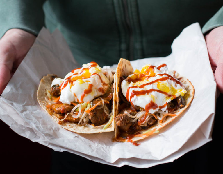 Kimchi Tacos are a delicious fusion hand food, with pickled veggies, Kimchi Jjigae marinated meat, tortillas, and poached eggs. | www.megiswell.com