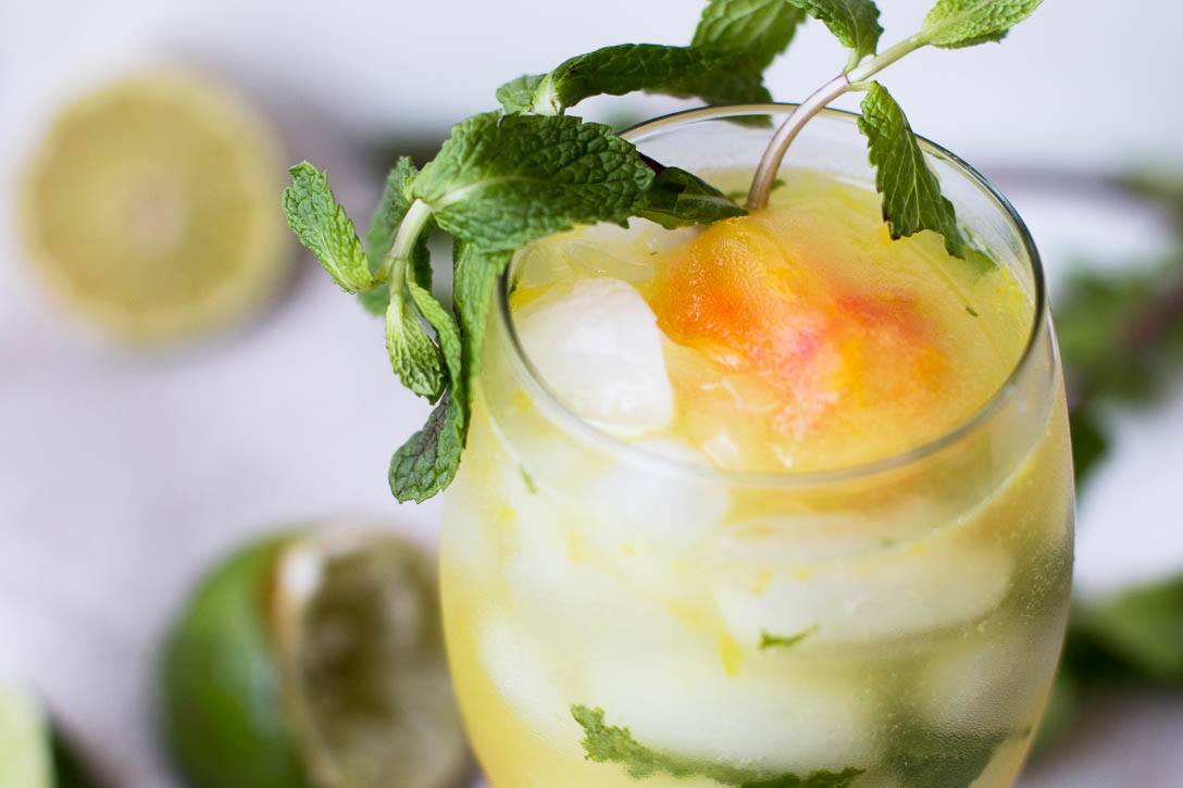 Put a sweet summer twist on the classic mojito by adding fruity simple syrup ice cubes, creating a sweet icy slush at the end of this Orange Pomelo Turmeric Mojito | www.megiswell.com