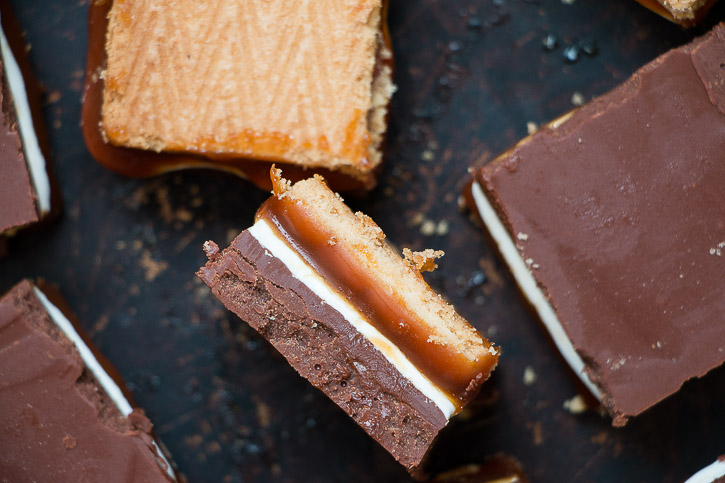 These no-bake Lorna Doone Chocolate Peanut Butter Bars are layered bites of everything good: cookies, salted caramel, marshmallow cream, and chocolate peanut butter. | www.megiswell.com