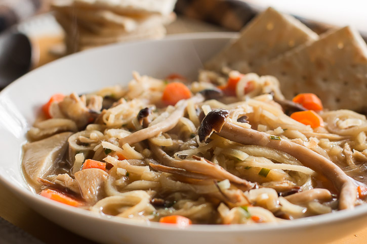 This Mushroom Medley Chicken and Parsnip Noodle Soup is perfect for recovering from the busy holiday season. Use leftover turkey from Thanksgiving or make it completely vegetarian for an extra healthy meal. | www.megiswell.com