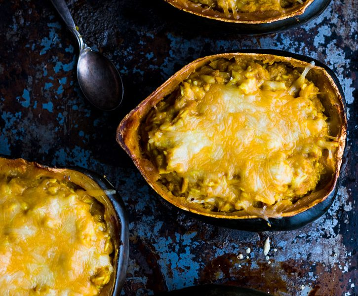 This Twice Baked Acorn Squash with Thai Yellow Curry and Chicken is extremely delicious. Yellow curry, coconut milk, shredded chicken, and jasmine rice all combine in a simple and comforting meal. | www.megiswell.com
