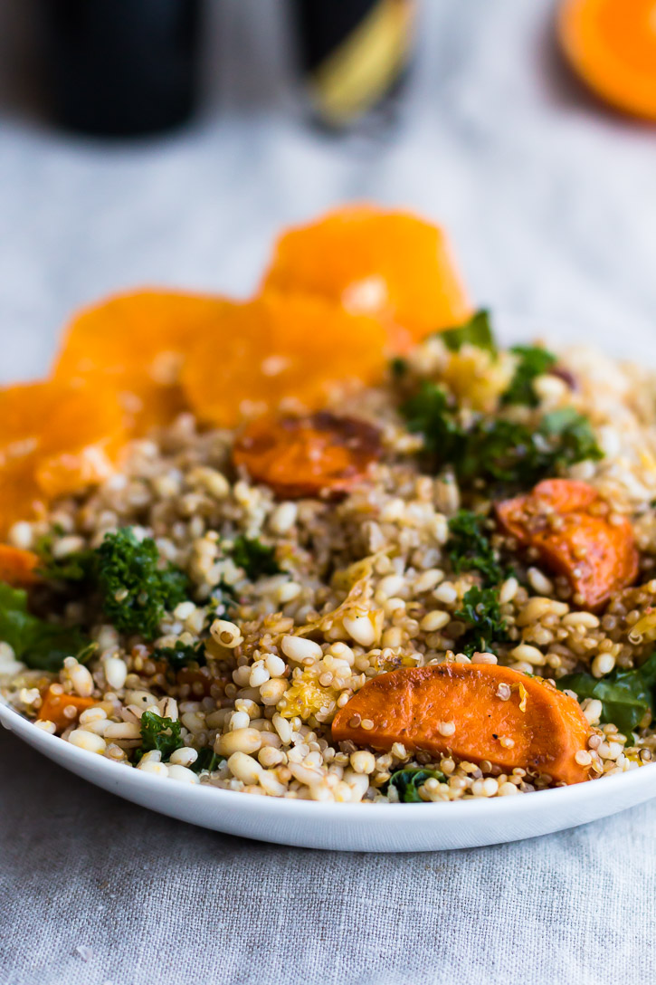 This Citrus, Kale, and Grain Salad is an amazing winter salad that is a combination of roasted oranges, red onion, and sweet potato-which provide sweet and fresh bursts of flavor, massaged kale, and roasted barley and quinoa, which adds depth and bulk. | www.megiswell.com