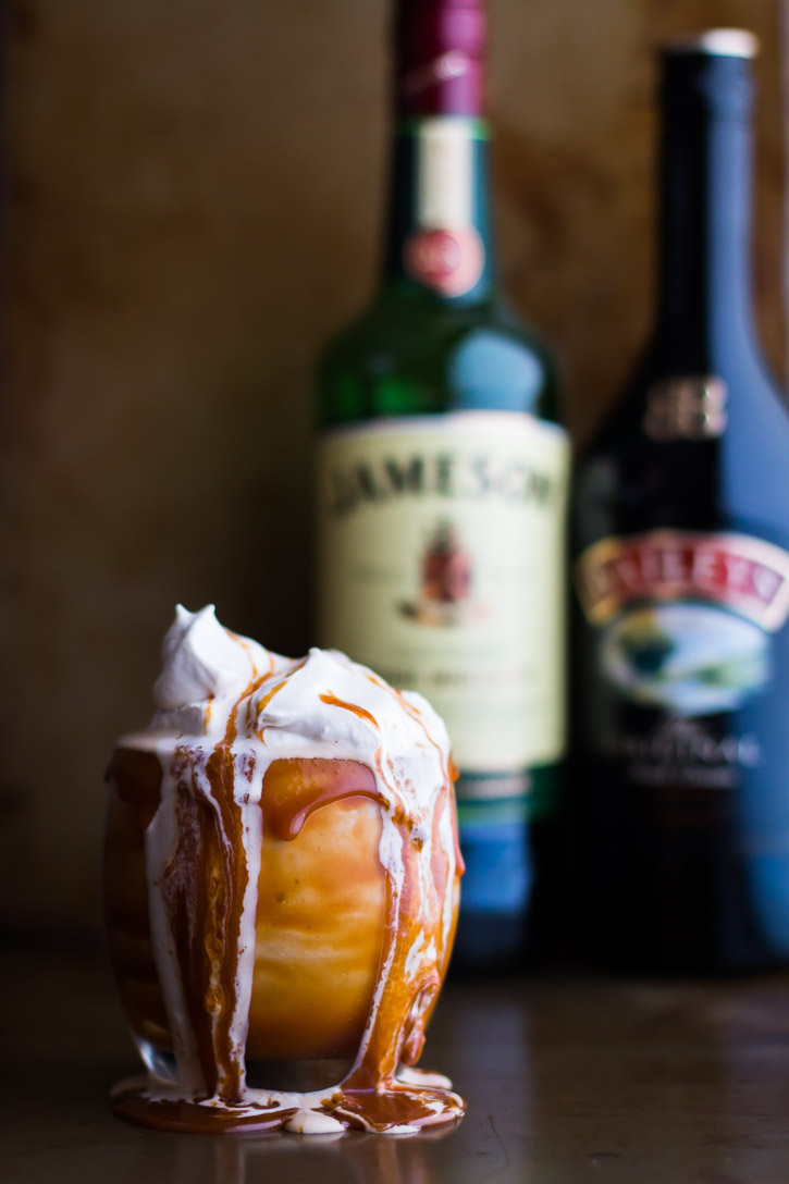 This Boozy Irish Coffee Milkshake with Baileys Caramel Drizzle is based off an Irish Coffee. Vanilla ice cream, espresso, and Jameson whiskey creates that Irish Coffee taste while Baileys caramel sauce and whipped cream enhance the flavor and increase the wow factor. | www.megiswell.com