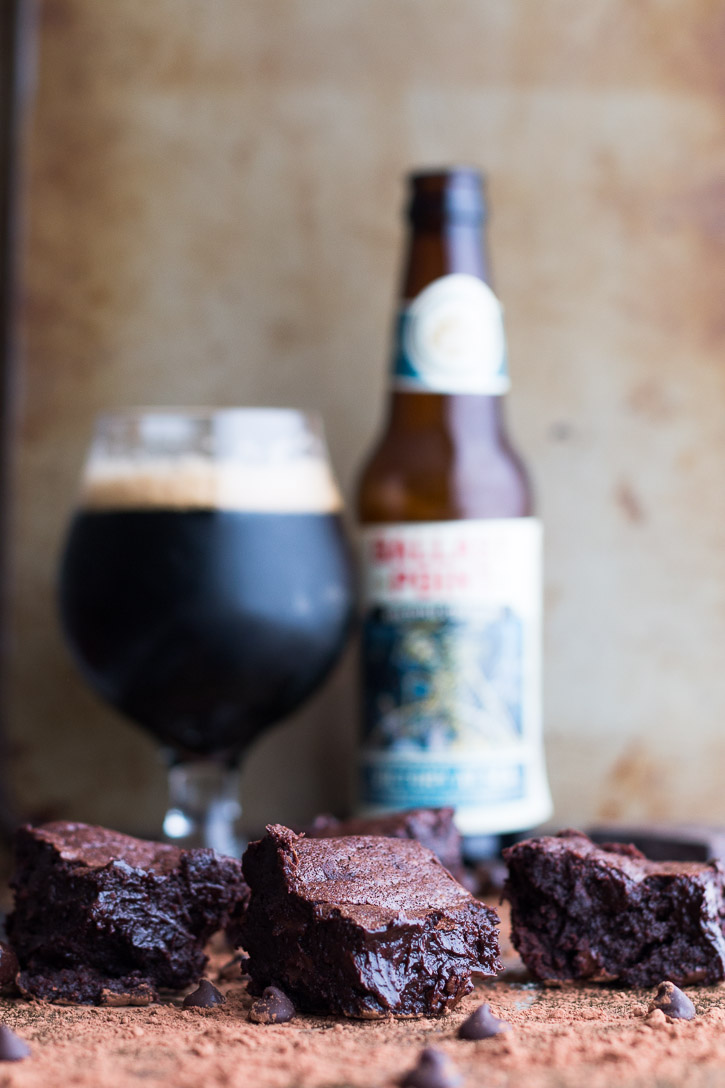 Using a stout or porter in these homemade Fudgy Beer Brownies brings out all the triple chocolaty and espresso gooey goodness. | www.megiswell.com