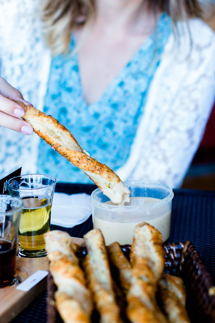 Puff Pastry Twists with parmesan, rosemary, and sea salt make great pub style finger food served with an easy IPA Cheese Beer Dip + Free Puff Pastry Tutorial Baking Guide | www.megiswell.com