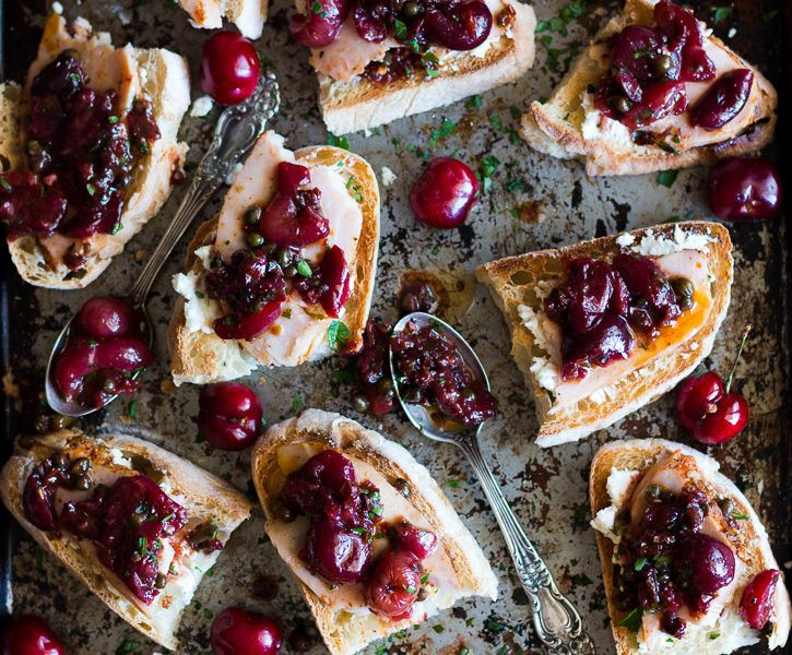 A sweet and slightly tart Roasted Cherry Caper Sauce, creamy goat cheese, and flavor packed hickory smoked turkey breast on toasted ciabbata bread make an easy summer appetizer. | Sponsored by Jennie-O | www.megiswell.com