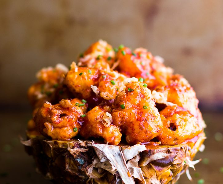 Cauliflower Tempura Bites are fried till golden brown and tossed with an addicting spicy Honey Ginger Sriracha Sauce. Perfect as a party appetizer, side dish, or meal!   Sponsored by House of Tsang   www.megiswell.com