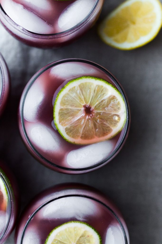 A combo of sour beer, orange juice, and red wine make this Shandy Punch a perfect summer drink for a party. | www.megiswell.com
