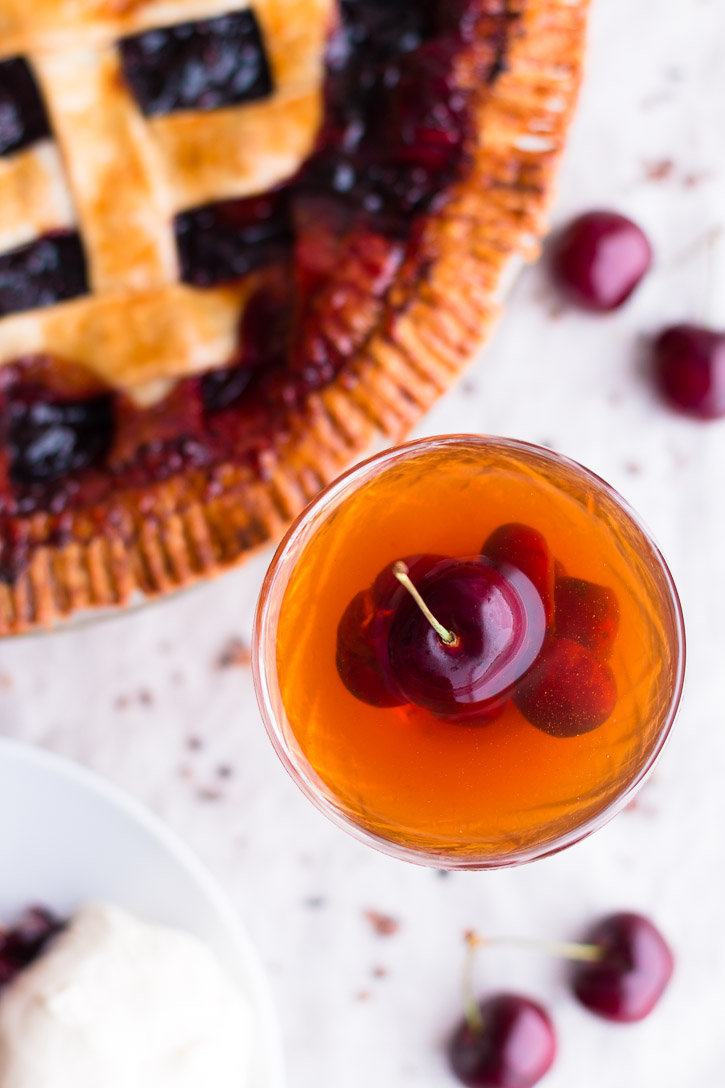 This Bourbon Cherry Pie with Cocoa Nibs is for bourbon and cocoa lovers. Dark and bitter chocolate melds beautifully with the vanilla undertones of bourbon and the sweetness of fresh dark cherries. Serve with a Bourbon Soaked Cherry Old Fashioned. | Dessert & Cocktail | www.megiswell.com