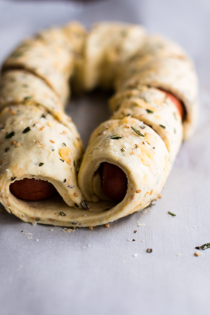 This Puff Pastry Sausage Braid is an easy and impressive looking side or appetizer. Especially when dipped into a Beer Cheese Sauce made with American wheat ale, cheddar, and smoked Gouda for a sweet n' smoky explosion of flavor.   www.megiswell.com
