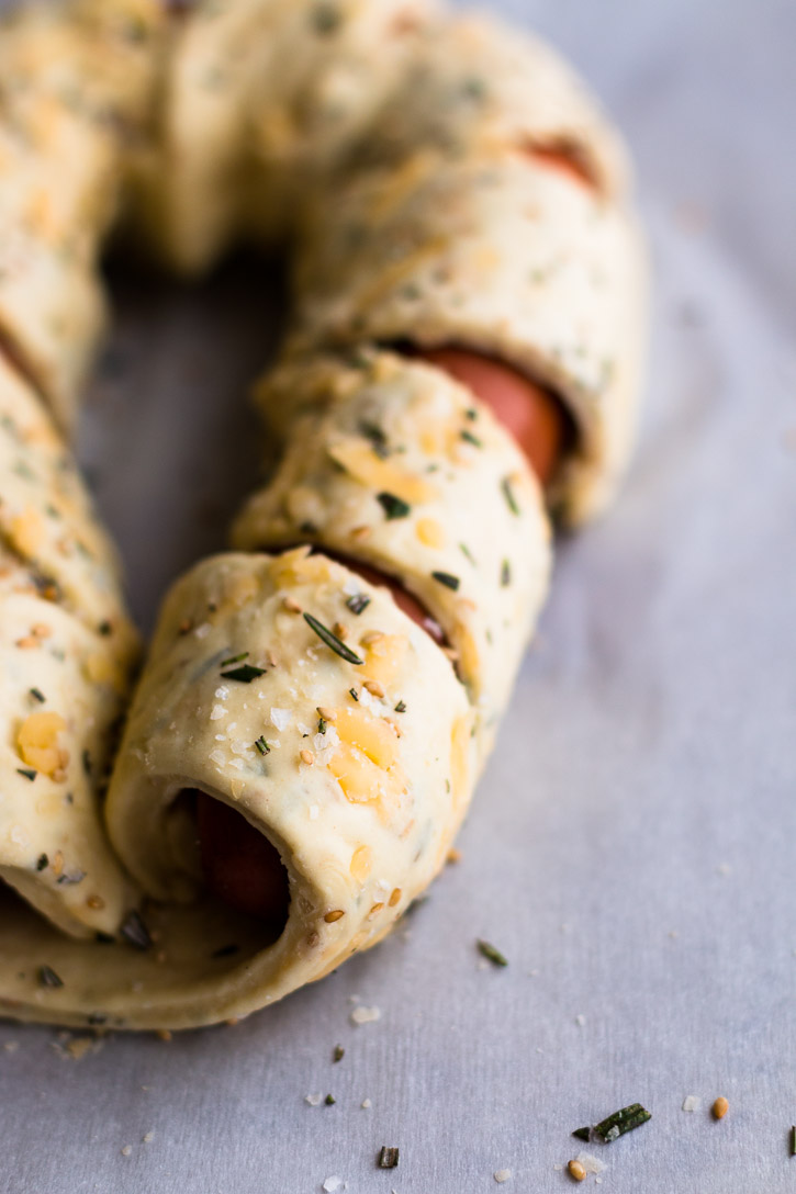 This Puff Pastry Sausage Braid is an easy and impressive looking side or appetizer. Especially when dipped into a Beer Cheese Sauce made with American wheat ale, cheddar, and smoked Gouda for a sweet n' smoky explosion of flavor. | www.megiswell.com