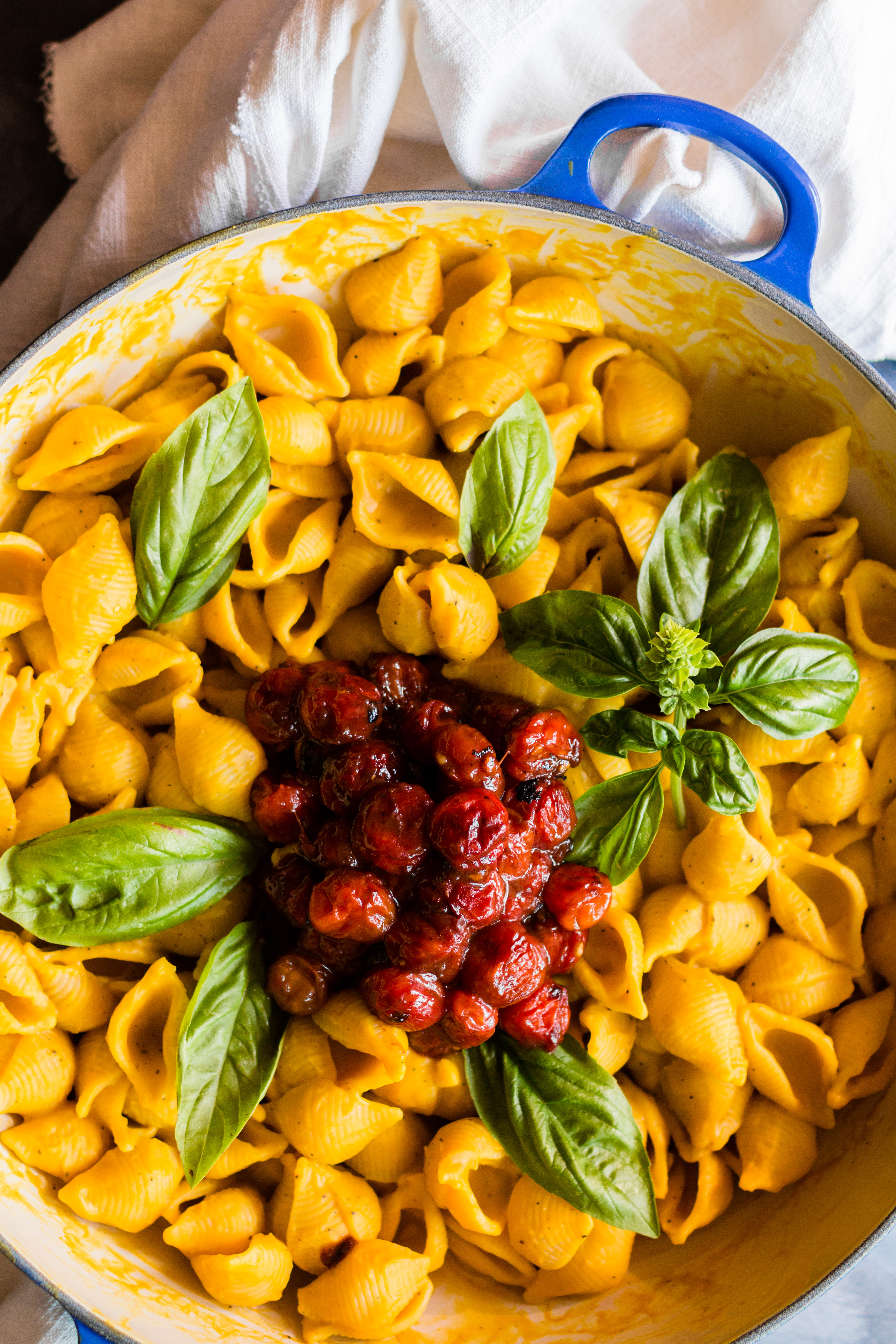 This Mac and Cheese with Vegan Pumpkin Cheese Sauce is so creamy and cheesy tasting, people will ask what kind of cheese you used. Serve with a side of slow roasted cherry tomatoes for an explosion of flavor. | #pumpkin #vegan | www.megiswell.com