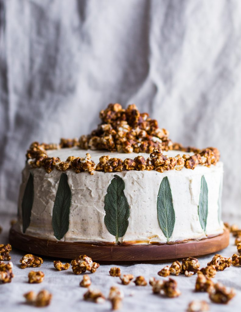 This Pumpkin Layer Cake with Brown Butter Salted Caramel, Tahini Sage Buttercream, and Caramel Corn is the ultimate fall cake. | #fall #pumpkin #cake | www.megiswell.com