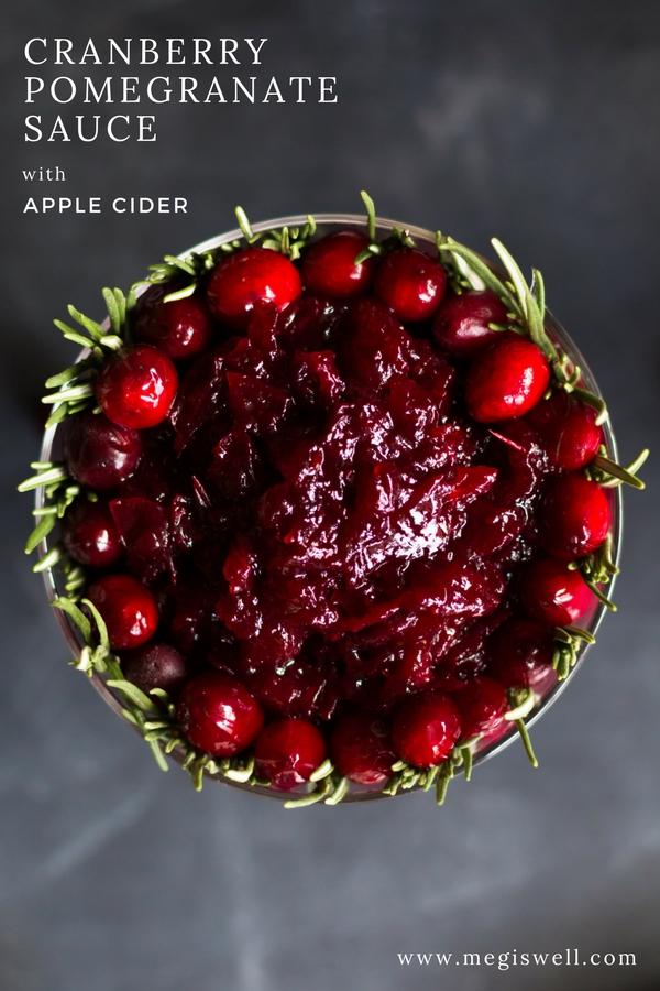 This homemade Cranberry Pomegranate Sauce with Apple Cider gets its sharp sweet and tart combo from apple cider, orange juice, pomegranates, and bourbon. | #Thanksgiving | www.megiswell.com