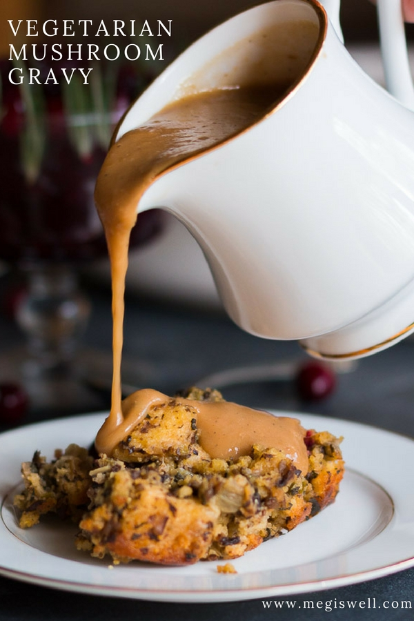 This Vegetarian Mushroom Gravy is savory and full of rich flavor thanks to an umami broth base that elevates the mushroom, onion, and flour roux. | #Thanksgiving #vegetarian | www.megiswell.com
