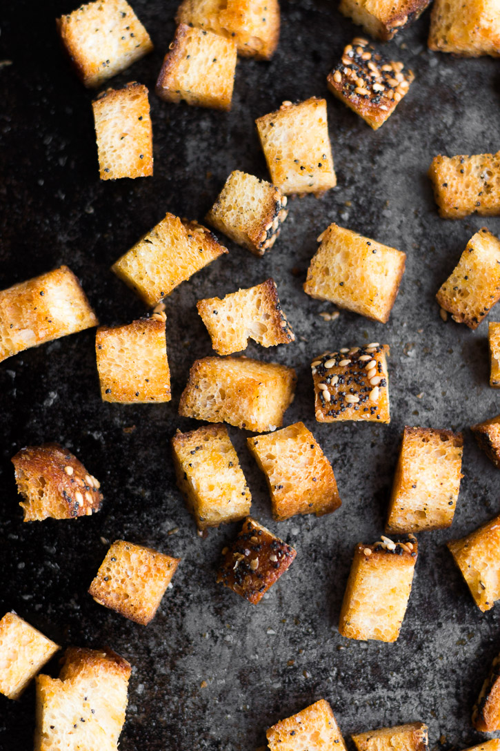 Baked and crunchy croutons on a baking sheet.