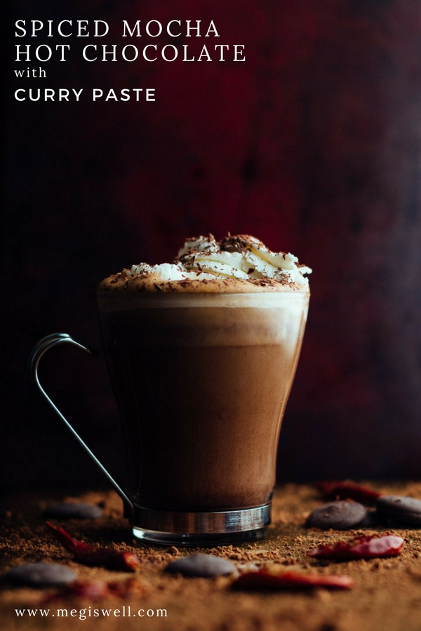 This Spiced Mocha Hot Chocolate with Curry Paste might seem strange. But a little bit of Thai Red Curry Paste, with its toasted spices, dried and fresh chilies, and aromatics, makes a complex and spicy mocha perfect for warming you up. | www.megiswell.com