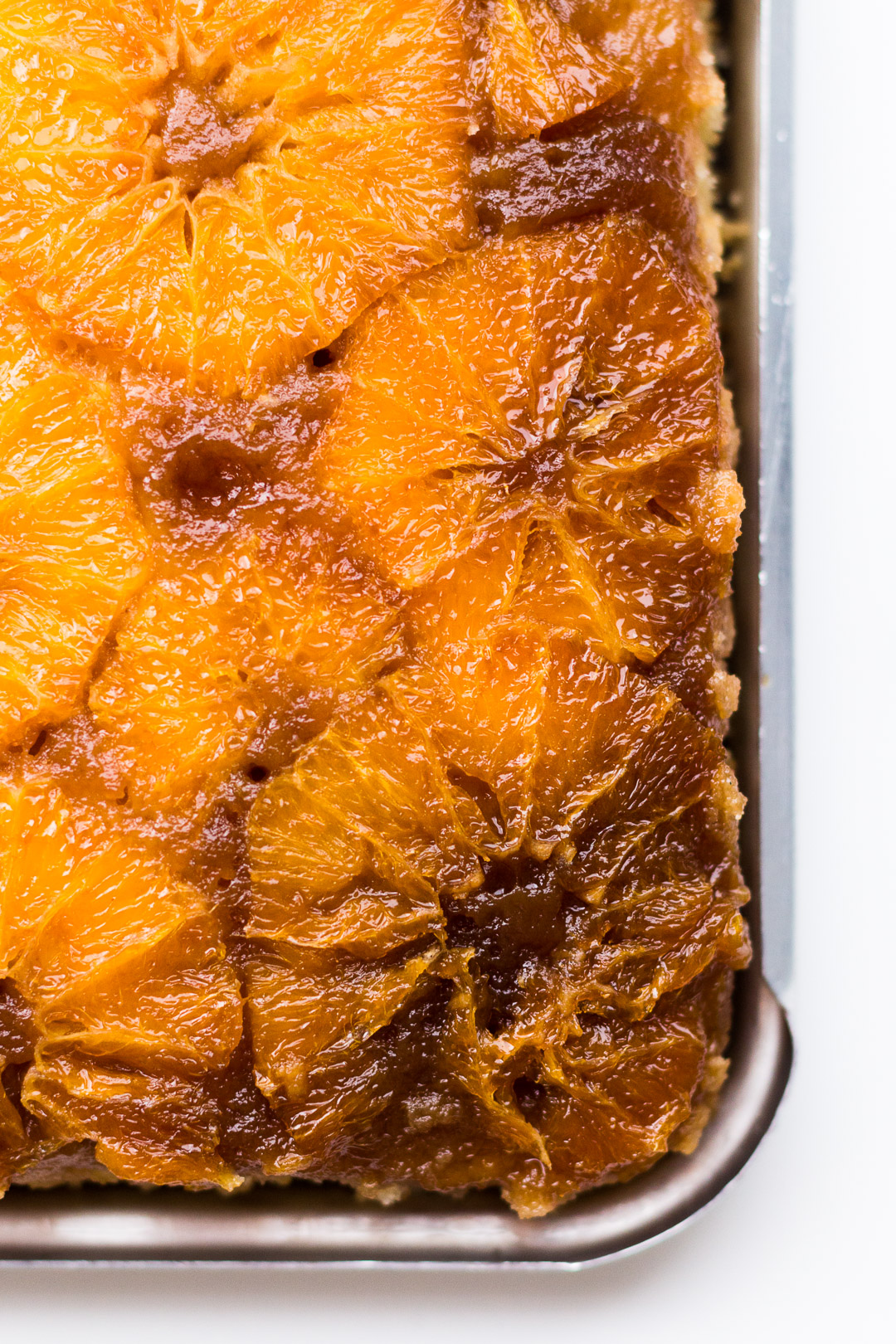 Close up overhead shot of the unglazed oranges on the upside down cake.