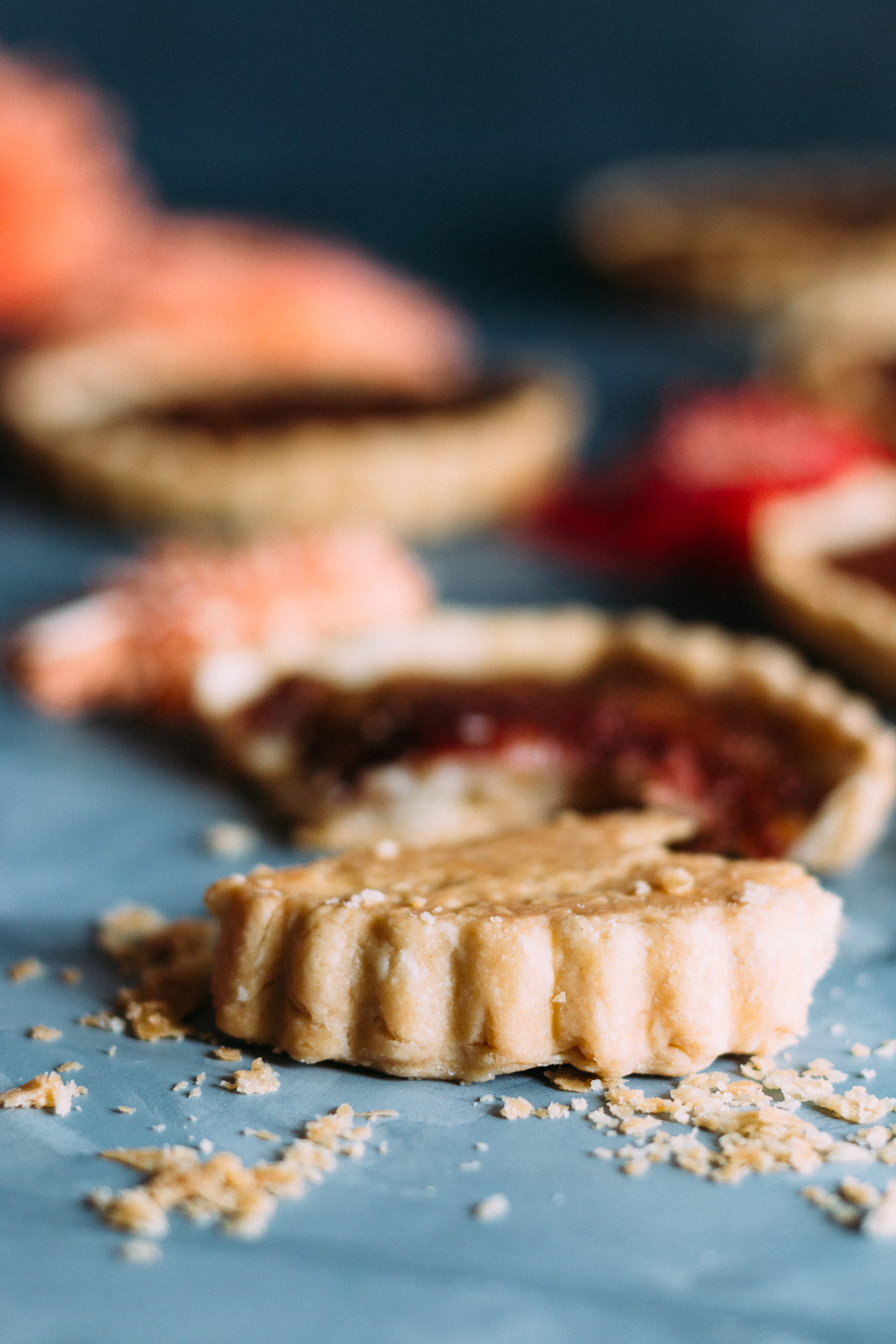 Vertical shot of a rhubarb tart's side and bottom crust.