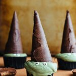 These chocolate Reese's Peanut Butter Cup Cupcakes have a secret peanut butter cup treat at the bottom and Reese's frosting. Decorated like witches, they are the perfect Halloween trick AND treat. #halloween #halloweencupcakes #partyrecipes #reeses #peanutbutter #chocolatecupcakes #reesescupcakes | www.megiswell.com