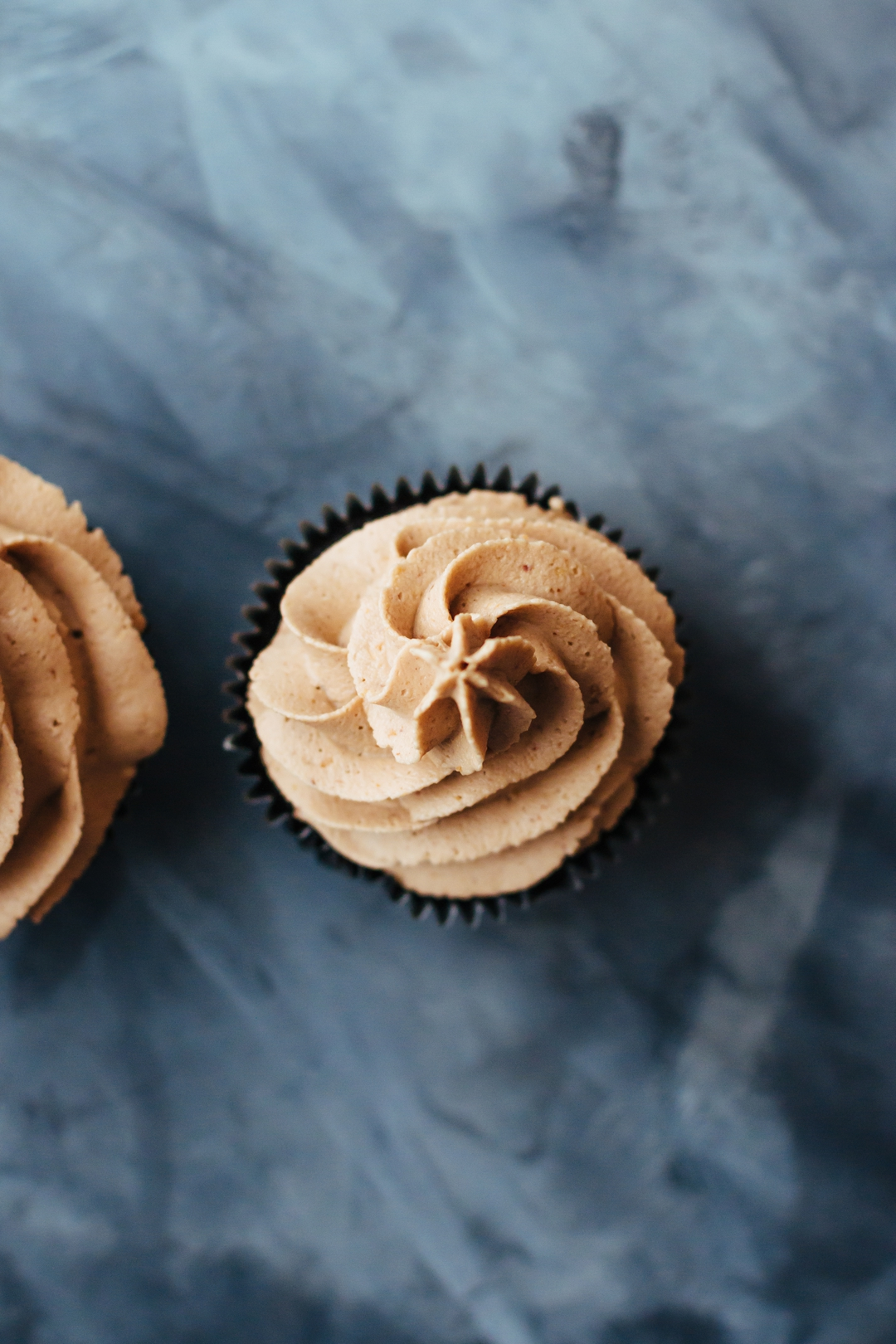 Overhead shot of the top of a frosted Reese's Peanut Butter Cup Cupcake.