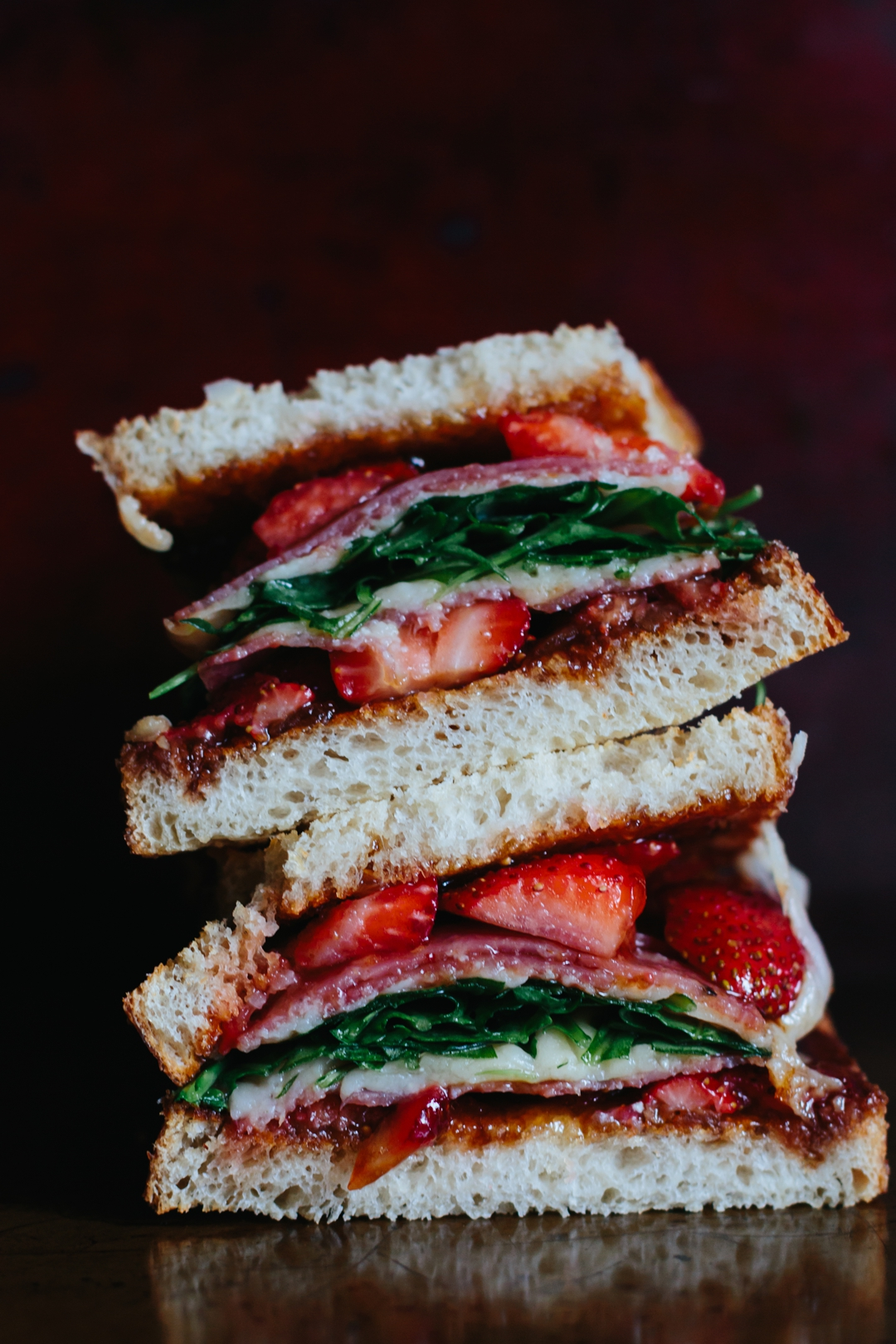 Strawberry Grilled Cheese is sweet and savory perfection with fig jam, balsamic soaked strawberries, salami, aged white cheddar, and arugula. #grilledcheese #sandwich #strawberries #figjam | www.megiswell.com