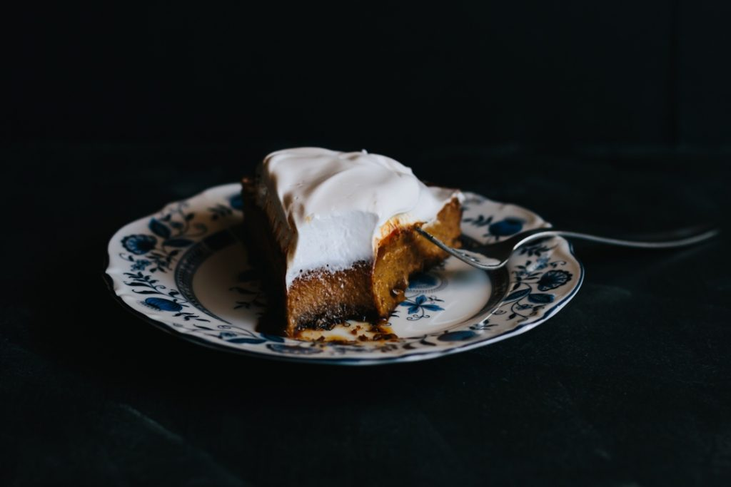 This Cookie Crust Pumpkin Pie takes pumpkin pie to the next level with a molasses or gingersnap cookie crust, salted caramel drizzle, and a topping of 7-minute frosting. | Thanksgiving | Holiday | Dessert | made from scratch | homemade | www.megiswell.com