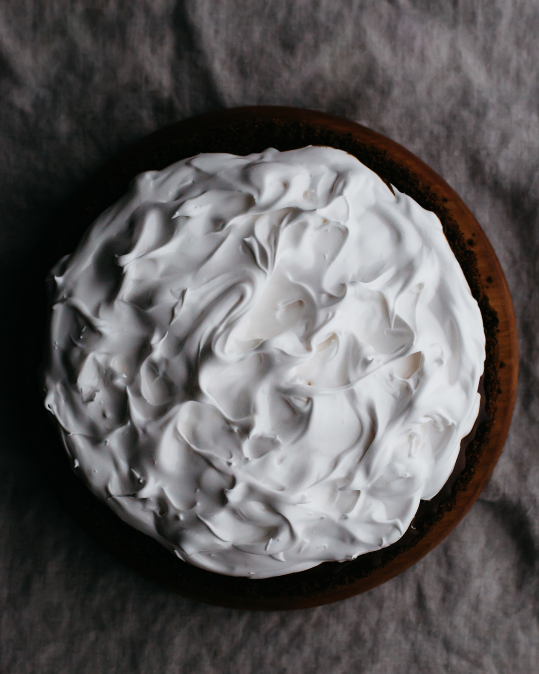 Overhead shot of pie topped with 7-minute frosting.