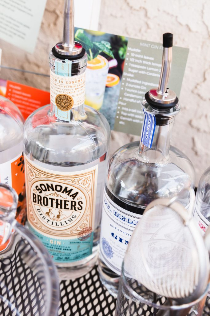 Vertical close up shot of a bottle of Sonoma Brothers Distilling gin on the DIY Gin Bar.