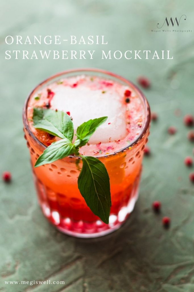 This Orange-Basil Strawberry Mocktail contains the sweet tartness of fresh strawberries, fresh squeezed orange juice, a warm peppery kick, and a refreshing basil aroma. You'll fit right into any party sipping on this! Non Alcoholic | Summer Drinks | Shrub Mocktail | #mocktail #megiswell #meganwellsphotography | www.megiswell.com